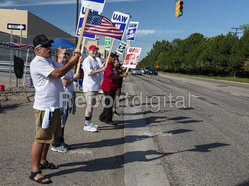 Flint, Michigan, USA: striking UAW workers picketing Flint Assembly Plant during their strike against GM. Many members wore white shirts to honor the Flint sit-down strikers of 1936-37. The main issues in the strike include plant closures, low wages and the two-tier pay structure - Jim West - 2019-09-24