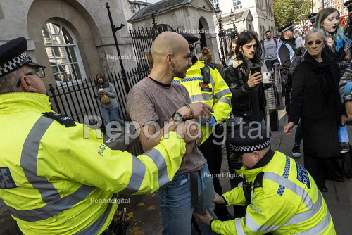 Police stop and search Extinction Rebellion, last day protesting against lack of Government action on climate change, Whitehall, London. - Jess Hurd - 2019-10-18