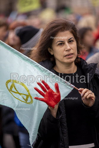 Extinction Rebellion red hand, last day protesting against lack of Government action on climate change. Nonviolent direct action shutting down central London. - Jess Hurd - 2019-10-18