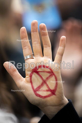 Extinction Rebellion red hand, last day protesting against lack of Government action on climate change. Downing Street, London. - Jess Hurd - 2019-10-18