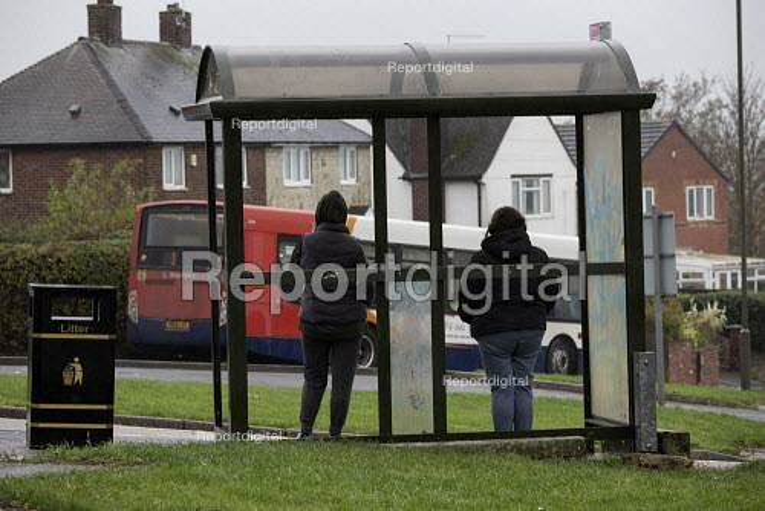 Women waiting at a bus stop, Bolsover, Derbyshire - John Harris - 2019-11-05