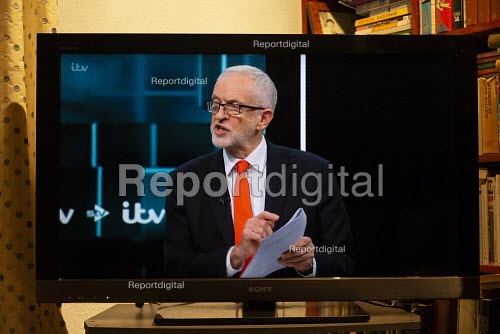 ITV general election debate, Boris Johnson, Jeremy Corbyn debating on TV. Corbyn confronting Johnson with papers from US Trade talks highlighting a secret plan to sell offNHS to American corporations - John Harris - 2019-11-19