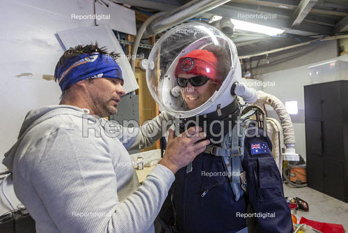 Hanksville, Utah USA: Mars Desert Research Station. Researchers simulate living on Mars. 'Expedition Boomerang' brought Australian researchers to the station. Steve Whitfield helps Dr. Shane Usher into his space suit. - Jim West - 2019-11-13