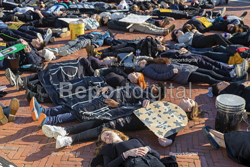 Washington DC USA. Young activists staged a die in during a Funeral for Future on Capitol Hill. They demanded that government addresses the crisis of climate change. It was part of Fridays for Future Global Day of Action - Jim West - 2019-11-29