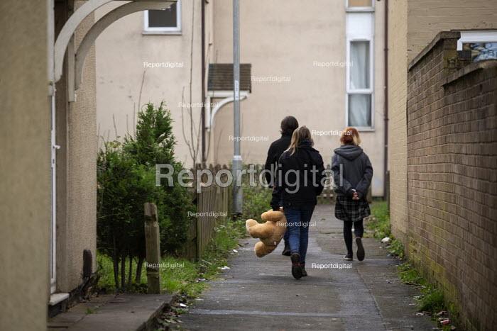 Youth with a teddy bear, Hazel Leys, Corby, Northamptonshire - John Harris - 2019-12-07