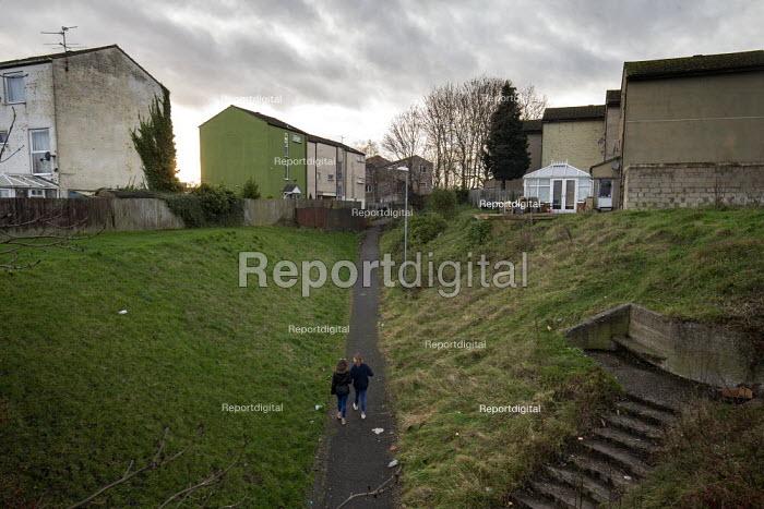 Youth walking through a housing estate, Hazel Leys, Corby, Northamptonshire - John Harris - 2019-12-07