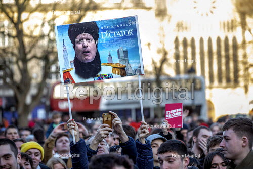 Boris Johnson The Dictator satirical film poster placard, Jeremy Corbyn speaking Labour Party Election Campaign Rally Bristol - Paul Box - 2019-12-09