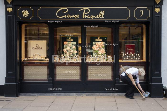 Woman sweeping up, George Pragnell, prestige jewellers, Stratford upon Avon, Warwickshire - John Harris - 2020-01-09