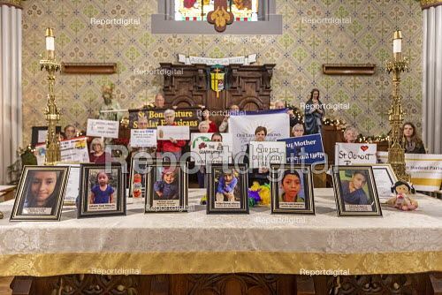 Detroit, Michigan USA, Holy Hour, supporting refugees fleeing violence, Most Holy Trinity Catholic Church. Photographs of children who died while in U.S. custody after crossing the border were placed on the altar. The event was organized by Strangers No Longer during the U.S. Catholic Bishops' National Migration Week. - Jim West - 2020-01-11