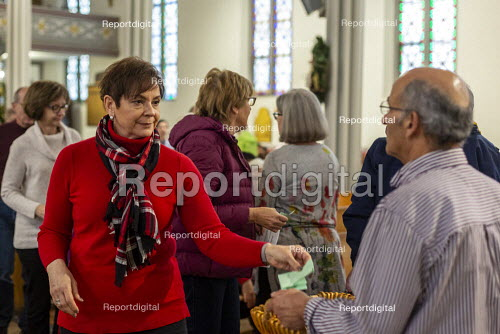 Detroit, Michigan USA, Holy Hour, supporting refugees fleeing violence, Most Holy Trinity Catholic Church. Parishoners commitments to prayer, fasting and action in support of migrants were collected in baskets. The event was organized by Strangers No Longer during the U.S. Catholic Bishops' National Migration Week. - Jim West - 2020-01-11