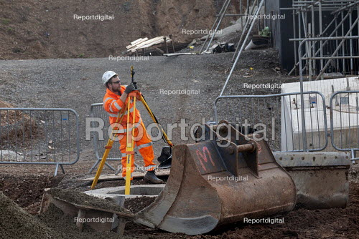 Surveyor at work, Construction site, Coventry & Warwickshire Gateway - John Harris - 2020-02-05