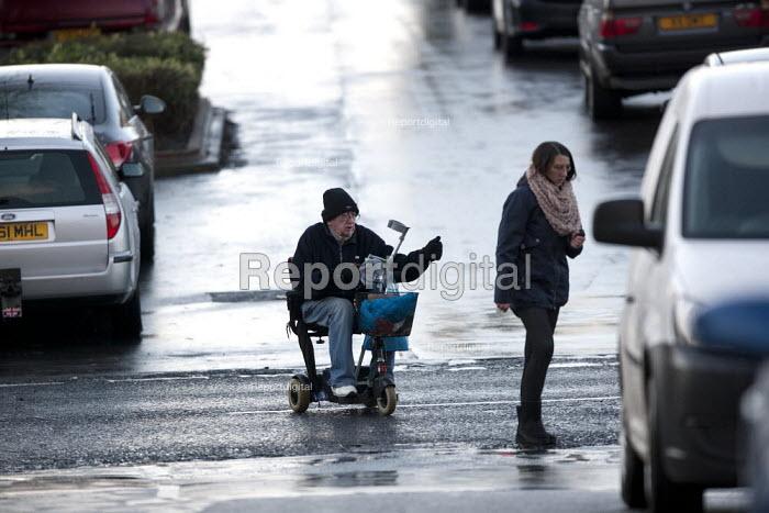 An elderly man crossing the road on a motorised scooter, Goldthorpe - John Harris - 2015-11-20