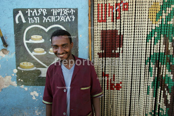 A waiter stands in front of a traditional pastry shop in the streets of the city of Harar, Ethiopia - Boris Heger - 2006-02-05