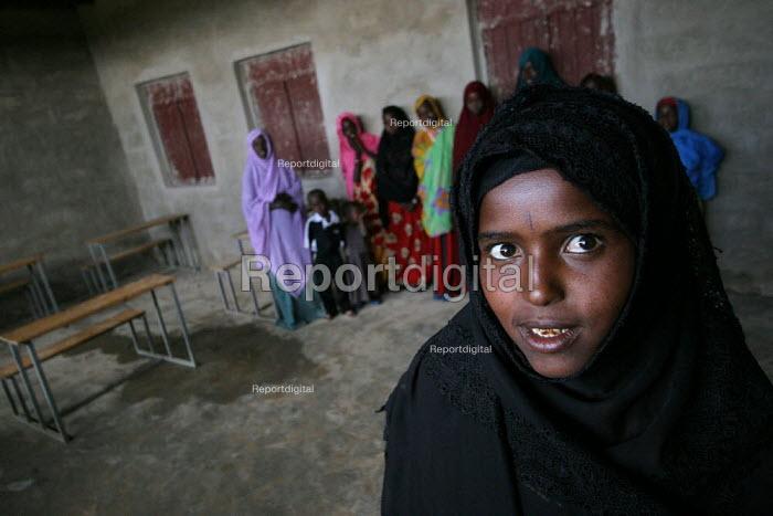 Hodan Mahmoud, 15, inside of the school of Hagadjin village, 35 km from Jijiga, Ethiopia, on Sunday, August 28, 2005. Hodan left school early because her parents needed her to help work at home. - Boris Heger - 2005-08-28