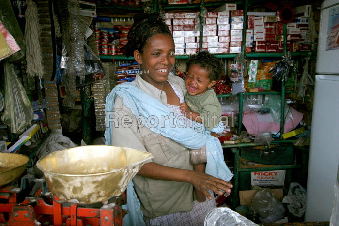 A mother and baby in the family shop, near Dire Dawa, Ethiopia, October 2005. - Boris Heger - 2005-10-26