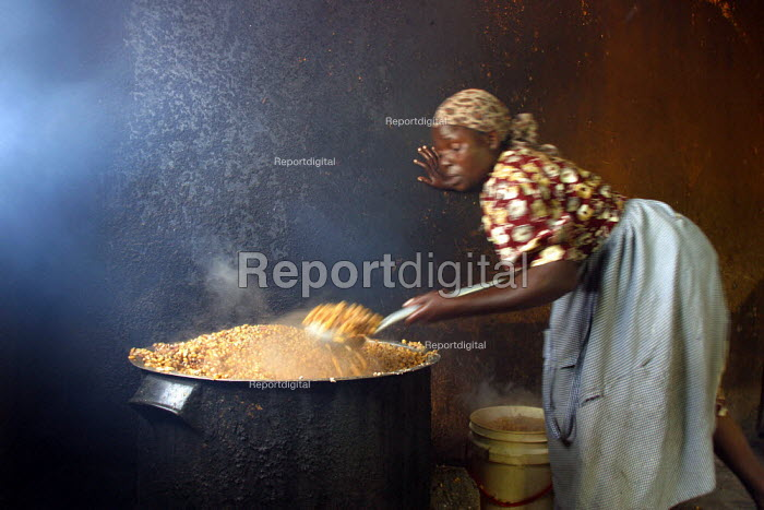 A lady prepares food, Kajiado school, Machakos rural area, Kenya, May 2004. Without food being given to children, most of them would not attend the classes as they would have to look for feeding themselves by their own means in this poor area. - Boris Heger - 2004-05-11