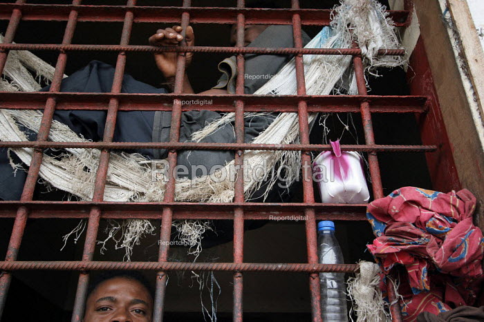 A detainee in his cell at the central prison of Monrovia, Liberia, February 2006. - Boris Heger - 2006-03-02