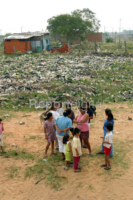 Locals in a slum nicknamed Vietnam in reference to its poor infrastructure. The area is right next to the citys dump and the wind brings its smell and plastic garbage, Santa Cruz, Bolivia, August 2004 - Boris Heger - 2006-08-29
