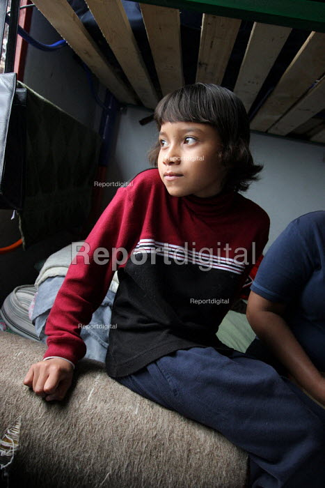A newly arrived girl in a displaced people center run by a charity in Los Altos de Cazuca, one of the most dangerous slum area of the capital city, mostly populated by people displaced by violence among illegal armed group in the countryside, Bogota, Colombia, January 2006. There are an estimated 3 millions people displaced by conflict between guerrilla groups. - Boris Heger - 2006-08-30