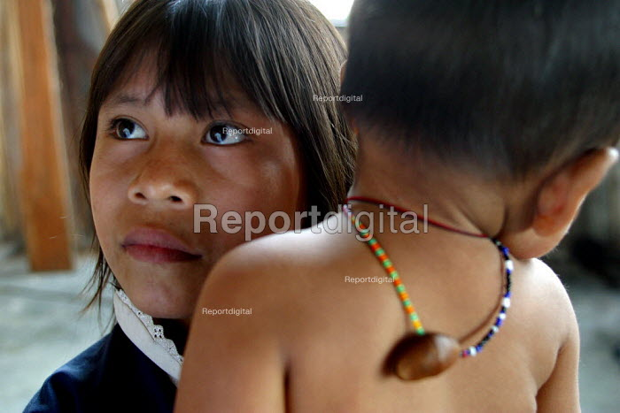 An indigenous girl and her young brother stay in a displaced people accommodation center in Quibdo, Choco region, Colombia, February 2004. There are an estimated 3 million people displaced by conflict with guerrilla groups. - Boris Heger - 2006-08-20