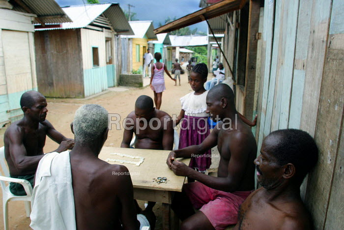 Unemployed people play dominoes at a displaced people accommodation center, in Quibdo, Choco region, Colombia, February 2004. There are an estimated 3 millions people displaced by conflict between guerrilla groups. - Boris Heger - 2006-08-20