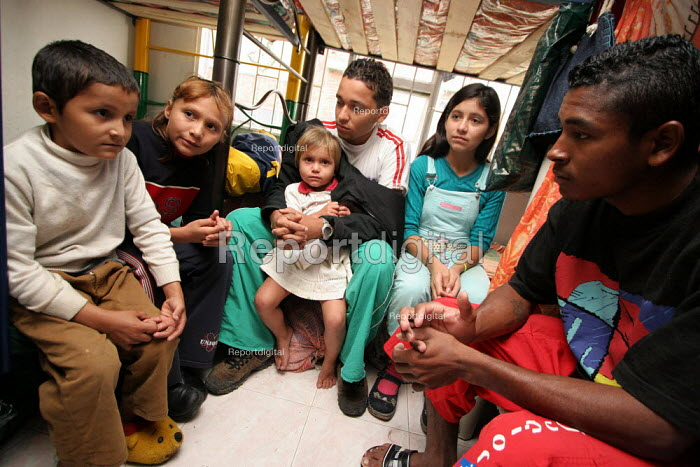 A newly arrived family in a displaced people center run by a charity in Los Altos de Cazuca, one of the worst slums of the capital city Bogota, Colombia, January 2006. There are an estimated 3 million people displaced by conflict with guerrilla groups. - Boris Heger - 2006-08-30