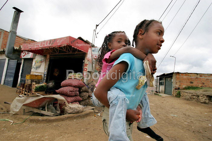 Displaced children play in the streets in Los Altos de Cazuca, one of the worst slums in Bogota, Colombia, January 2006. There are an estimated 3 million people displaced by conflict with guerrilla groups. - Boris Heger - 2006-08-30