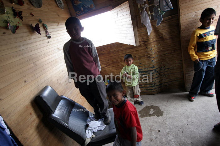 Displaced children play in their shelter, in Los Altos de Cazuca, one of the worst slums in Bogota, Colombia, January 2006. There are an estimated 3 million people displaced by conflict with guerrilla groups. - Boris Heger - 2006-08-30