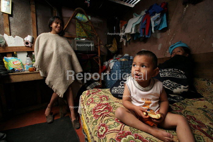 A displaced family in their shelter, in Los Altos de Cazuca, one of the worst slums in Bogota, Colombia, January 2006. There are an estimated 3 million people displaced by conflict with guerrilla groups. - Boris Heger - 2006-08-30