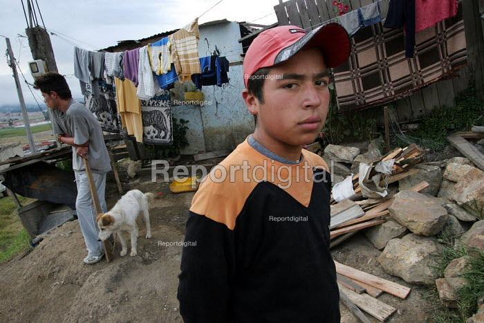 A displaced family outside of their shelter, in Los Altos de Cazuca, one of the worst slums in Bogota, Colombia, January 2006. There are an estimated 3 million people displaced by conflict with guerrilla groups. - Boris Heger - 2006-08-30