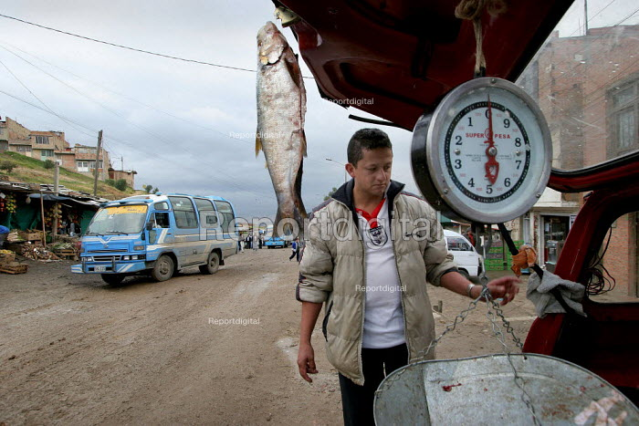 Foodstall and local transport, in Los Altos de Cazuca, one of the worst slums in Bogota, Colombia, January 2006. There are an estimated 3 million people displaced by conflict with guerrilla groups. - Boris Heger - 2006-08-30
