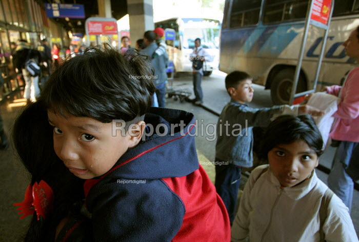 Crying child. A displaced family arrive at the central bus station, where the displaced arrive day after day, Bogota, Colombia, January 2006. There are an estimated 3 million people displaced by conflict with guerrilla groups. - Boris Heger - 2006-08-30