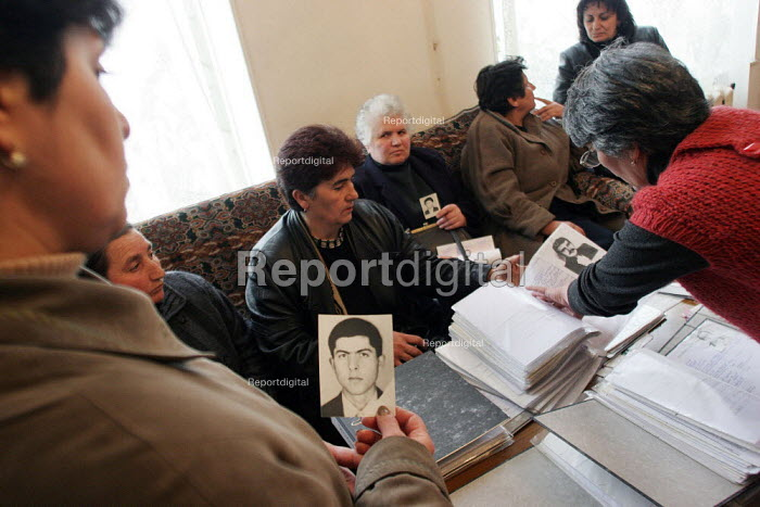 Relatives of soldiers and civilans who disappeared during the conflict between Armenia and Azerbaijan over the Nagorno Karabakh region gather together during a meeting in Yerevan, Armenia, February 2005. People display images of their relatives and check their relevant files. - Boris Heger - 2005-03-01