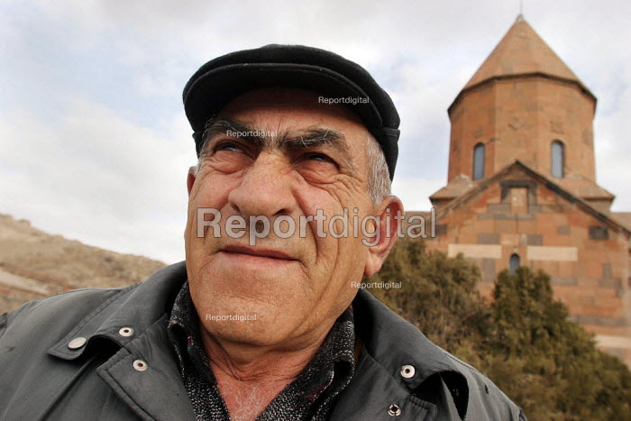 An old man in front of 14th centurys Orthodox Monastery of Khor Virap, near the border with Turkey, Armenia, February 2005. - Boris Heger - 2005-03-02