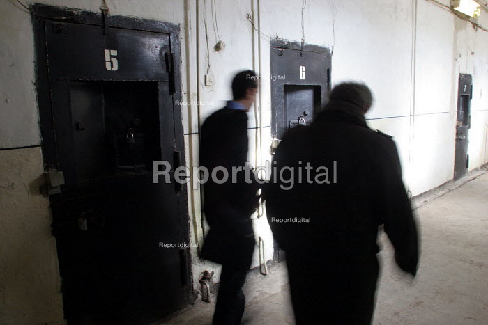 Lawyers pass in front of detainees cells in the central prison of Goris, Armenia, February 2005. - Boris Heger - 2005-03-02