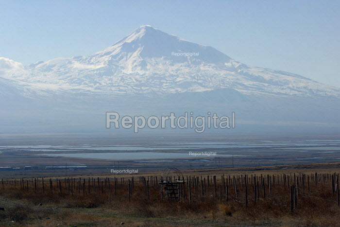 A rare sunny view of the famous Mount Ararat, located just after the border with Turkey, Khor Virap, Armenia, February 2005. According to the Bible account in the book of Genesis, Noahs Ark came to rest over 4300 years ago on this mountain. - Boris Heger - 2005-03-05