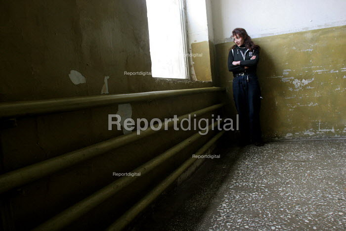 A lone woman watches through a window in the woman and minors prison of Abovian, Erevan, Armenia, February 2005. - Boris Heger - 2005-02-28
