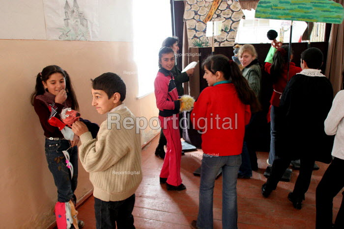 Children prepare a puppet show at the elementary school, Khnatzakh, Nagorno Karabakh, Azerbaidjan, March 2005. The region, although officially located within Azerbaidjan, is being occupied by Armenia and has became a de facto Republic strongly linked with Armenia. The conflict, considered is still pending and the status of Nagorno Karabakh is unresolved. - Boris Heger - 2005-03-03
