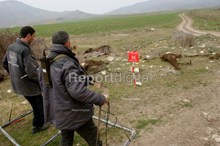 Deminers from the non-governmental organization Halo Trust - The Hazardous Areas Life-Support Organisation - are at work along the old front line, 500 metres from the local school. Entire fields are still off-limits to farmers, and mine accidents have become a regular occurrence since the ceasefire in 1994. The region, although officially located within Azerbaidjan, is being occupied by Armenia and has became a de facto Republic strongly linked with Armenia. The conflict, considered is still pending and the status of Nagorno Karabakh is unresolved. - Boris Heger - 2005-03-03