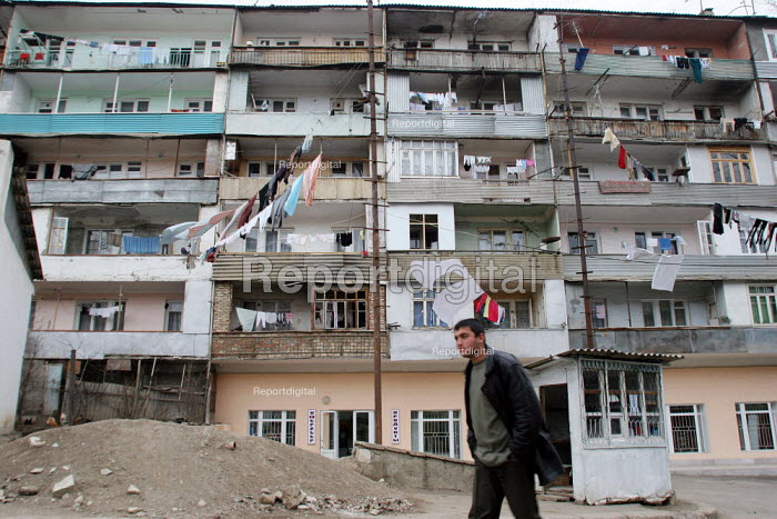 Typical street view with clothes drying up between houses in Stepanakert, Nagorno Karabakh, Azerbaidjan, March 2005. The region, although officially located within Azerbaidjan, is being occupied by Armenia and has became a de facto Republic strongly linked with Armenia. The conflict, considered is still pending and the status of Nagorno Karabakh is unresolved. - Boris Heger - 2005-03-03