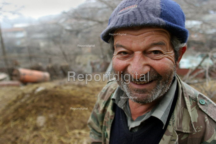 Old man, Azokh, Nagorno Karabakh, Azerbaidjan, March 2005. The region, although officially located within Azerbaidjan, is being occupied by Armenia and has became a de facto Republic strongly linked with Armenia. The conflict, considered is still pending and the status of Nagorno Karabakh is unresolved. - Boris Heger - 2005-03-04