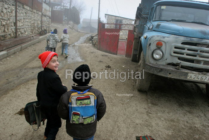 Children coming back from school, Azokh, Nagorno Karabakh, Azerbaidjan, March 2005. The region, although officially located within Azerbaidjan, is being occupied by Armenia and has became a de facto Republic strongly linked with Armenia. The conflict, considered is still pending and the status of Nagorno Karabakh is unresolved. - Boris Heger - 2005-03-04