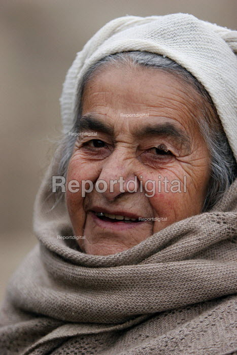 Old lady in Azokh, Nagorno Karabakh, Azerbaidjan, March 2005. The region, although officially located within Azerbaidjan, is being occupied by Armenia since a deadly war got in stand by in 1994 and became a de facto Republic strongly linked with Armenia. The conflict, considered as the most deadly one at the fall of the Soviet Empire, is still pending and no definite status has yet been given to Nagorno Karabakh. - Boris Heger - 2005-03-04
