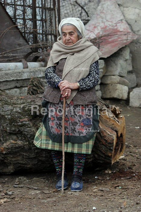 Old lady in the street of Azokh, Nagorno Karabakh, Azerbaidjan, March 2005. The region, although officially located within Azerbaidjan, is being occupied by Armenia since a deadly war got in stand by in 1994 and became a de facto Republic strongly linked with Armenia. The conflict, considered as the most deadly one at the fall of the Soviet Empire, is still pending and no definite status has yet been given to Nagorno Karabakh. - Boris Heger - 2005-03-04