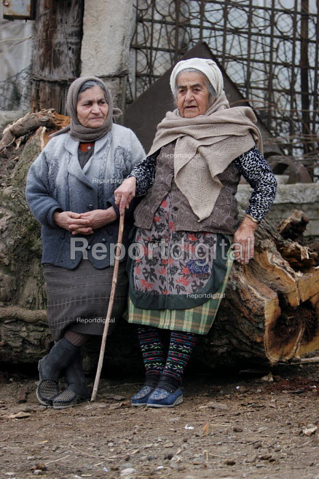 Old ladies, Azokh, Nagorno Karabakh, Azerbaidjan, March 2005. The region, although officially located within Azerbaidjan, is being occupied by Armenia since a deadly war got in stand by in 1994 and became a de facto Republic strongly linked with Armenia. The conflict, considered as the most deadly one at the fall of the Soviet Empire, is still pending and no definite status has yet been given to Nagorno Karabakh. - Boris Heger - 2005-03-04