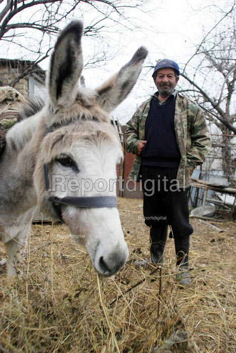Old man and donkey, Azokh, Nagorno Karabakh, Azerbaidjan, March 2005. The region, although officially located within Azerbaidjan, is being occupied by Armenia since a deadly war got in stand by in 1994 and became a de facto Republic strongly linked with Armenia. The conflict, considered as the most deadly one at the fall of the Soviet Empire, is still pending and no definite status has yet been given to Nagorno Karabakh. - Boris Heger - 2005-03-04