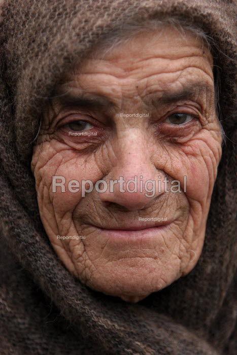 Old lady, Azokh, Nagorno Karabakh, Azerbaidjan, March 2005. The region, although officially located within Azerbaidjan, is being occupied by Armenia since a deadly war got in stand by in 1994 and became a de facto Republic strongly linked with Armenia. The conflict, considered as the most deadly one at the fall of the Soviet Empire, is still pending and no definite status has yet been given to Nagorno Karabakh. - Boris Heger - 2005-03-04