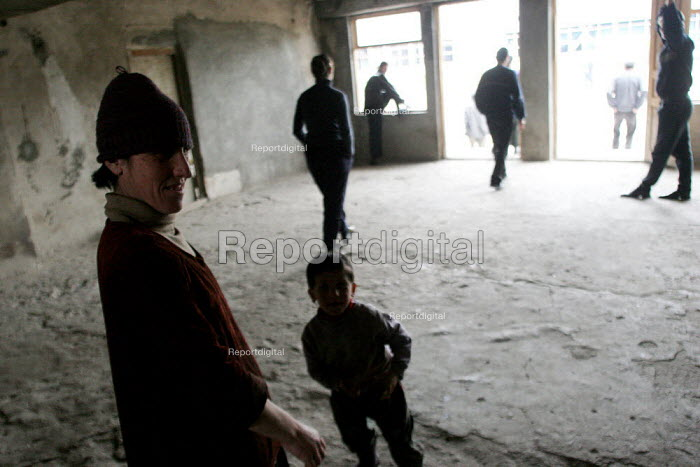Children play in delapitated residential block transformed into a displaced persons center for Georgians who used to live in Abkhazia, Zugdidi, Georgia, March 2005. The region of Abkhazia, officially still part of Georgia, conducted a separatist war with Georgia for years at the fall of the USSR and became a de facto republic supported by Russia. Its status is not officially resolved. - Boris Heger - 2005-03-08