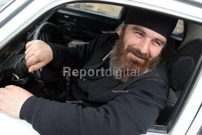 An orthodox priest drives his car, Zugdidi, Georgia, March 2005. - Boris Heger - 2005-03-08