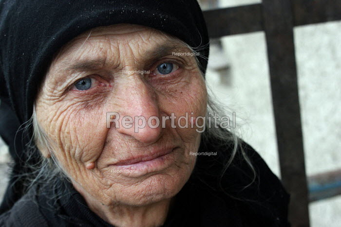 Displaced old woman, Georgian who used to live in Abkhazia, Kutaisi, Georgia, March 2005. The region of Abkhazia, officially still part of Georgia, conducted a separatist war with Georgia for years at the fall of the USSR and became a de facto republic supported by Russia. Its status is not officially resolved. - Boris Heger - 2005-03-10